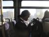 Sophomore Jasia Tolbert checks her phone as she waits for the Ride KC bus to reach STA Nov. 29. photo by Alex Davis
