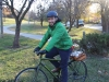 Theology teacher Michael Sanem rides his back back home after school Nov. 29. Sanem  has been riding his bike to and from school for a year now. photo by Alex Davis