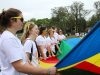 Seniors, from left, Claire Cain, Maggie Knox, Ali Yancey, Gwen Robertson, and Claire Finn wave a rainbow parachute on the day of the color run.