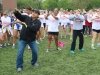 Facilities Manager, Rafael Ramirez, guides students in a dance during the color run . photo by Violet Cowdin