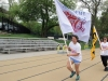 Senior class president Kat Mediavilla, left, and vice president Mary Hilliard, right, wave the flags of STA at the Walk of Fame April 22. photo by Maggie Knox
