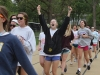 Senior Meg Thompson, center, cheers as the seniors complete their final lap at the Walk of Fame April 22. photo by Maggie Knox