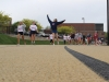 Senior Lily Cosgrove, center, dances as she walks around the track at the Walk of Fame April 22. A DJ at the event played songs as students walked,danced, socialized and played. photo by Maggie Knox