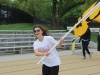 Senior class vice president Mary Hilliard runs with the STA flag at the Walk of Fame April 22. photo by Maggie Knox