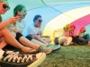 From left, seniors Gwen Robertson, Gillian Cutter, Claire Finn, Amber Brownlee, Sarah Wunder and Amelia Redick sit under a parachute on the field April 22 at the Walk of Fame. photo by Maggie Knox