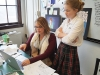 Ms. Scott and Freshman Windmoor staff member, Evelyn Moser, look over some page designs for the magazine. photo by Violet Cowdin