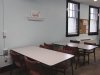 The Center contains two long tables with chairs where students can come to work on their writing and assignments.
