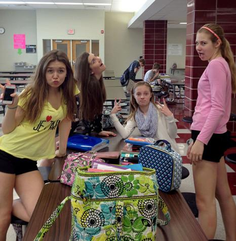 Current SME sophomore, Emma Vaughters, left, sits with her fellow Indian Hills Middle School classmates in their first period study hall. photo compiled by Elsa Feigenbaum