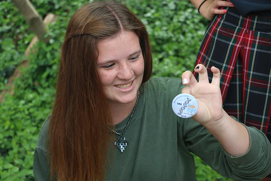 Freshman Olivia Matlock finds a geocache April 17. Matlock is a member of STEM club. photo by Maria Donnelly