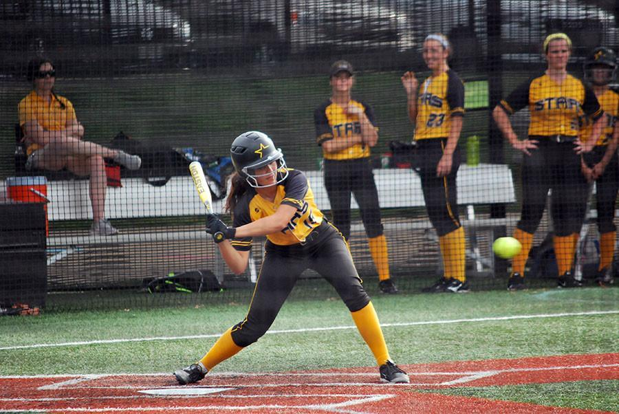 Freshman Lindsey Blaich swings at the ball at the home game against Benton High School Wednesday Sept 23. photo by Libby Hutchinson