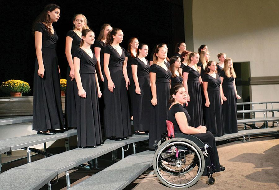 The STA concert choir opens a show at the fall choir concert held in Oct. 2014. The choir consisted of current STA sophomores. photo by Siobhan Miller