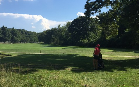 Sophomore Emma Anielak approaches the next hole at a practice. photo courtesy of Claire Franey.