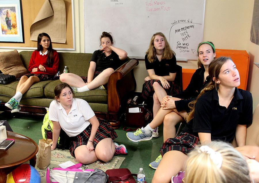 From left, freshman Grace Marshall and juniors Yesenia Eichholz, Jaime Hafenstine, Annie Hart, Claire Fiorella and Tess Rellihan watch a presentation in a Students for Life Club meeting Sept. 23. The presenation was about the death penalty, which the club is focusing their conversations on this fall.