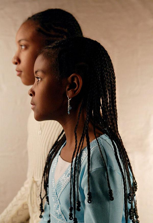 Sisters Jamila Jenkins, 10, left, and Johari, 7, wear their hair braided in cornrows, accented with beads. (Mei-Chun Jau/Dallas Morning News/KRT)