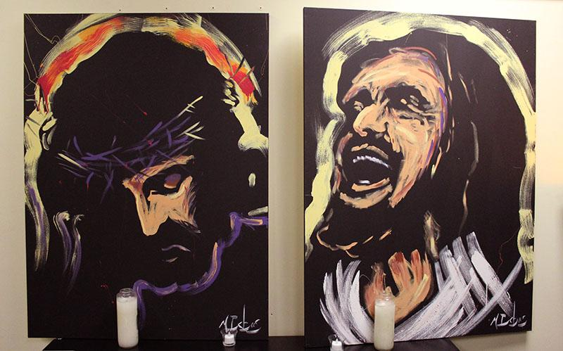 Two tapestries portraying the Passion of Christ hang in the Campus Ministry office. The room features an abundance of religious artwork. photo by Meg Thompson