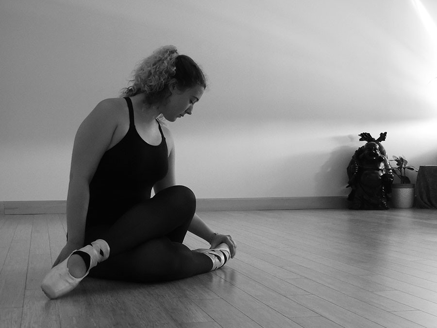 Senior Amber Brownlee poses wearing her pointe shoes at her mother's yoga and pilates studio Aug. 22. photo by Maddy Medina