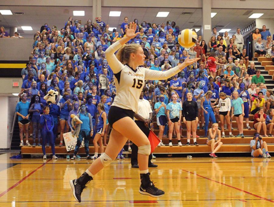 Senior Delaney Meyer serves the ball during the STA vs. Sion game held in the Goppert Center Sept. 16. Meyer was recently named one of three team captains for the 2015 volleyball season. photo by Kat Mediavilla