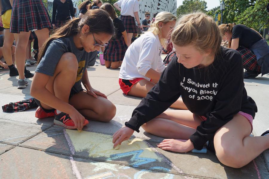 Freshmen advisory sisters take part in the chalk drawing contest during the frosh fest Sep. 4. photo by Violet Cowdin
