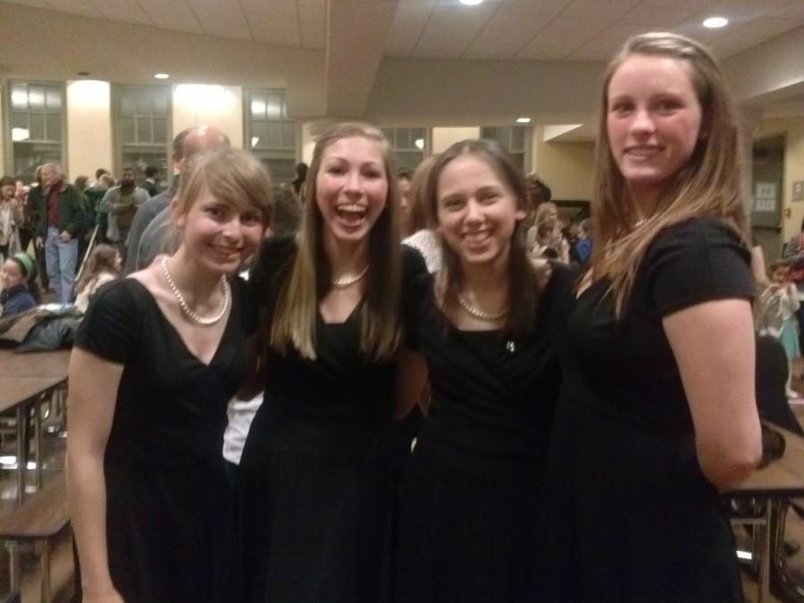 STA choir students pose in the commons after a concert.