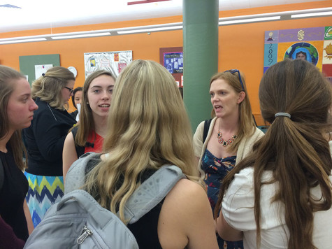 Debate coach Kate Absher, right, speaks with STA debate team members after their first competition Sept. 30. photo by Helen Wheatley