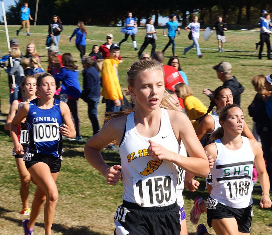 Freshman Addie Coppinger runs alongside 165 other runners in the Missouri cross country Class 4 girls State race on November 7, finishing 51st. photo by Katie Donnellan