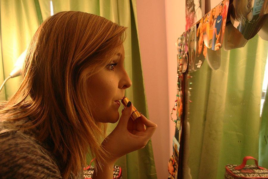 Junior Lizy Hagan applies lipstick in her bedroom Nov 24. photo by Cassie Hayes