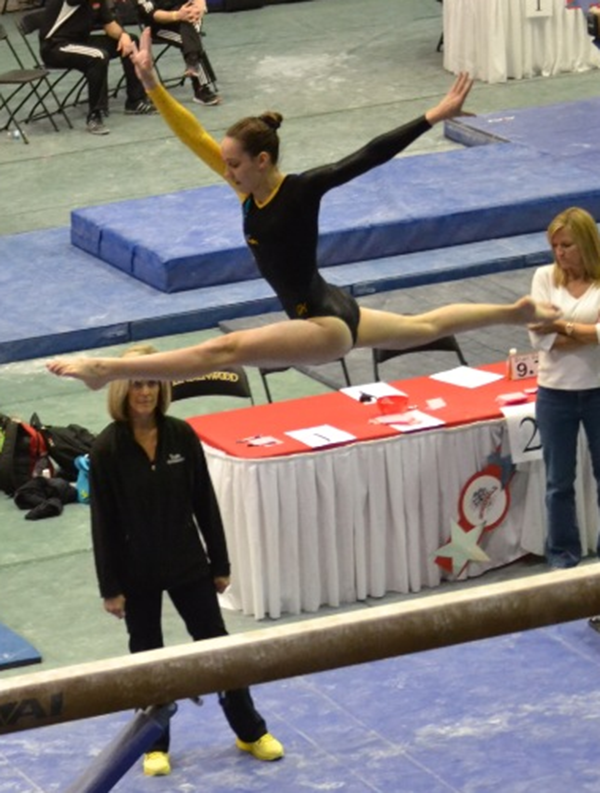 Senior Sara Stubbendieck on the balance beam.