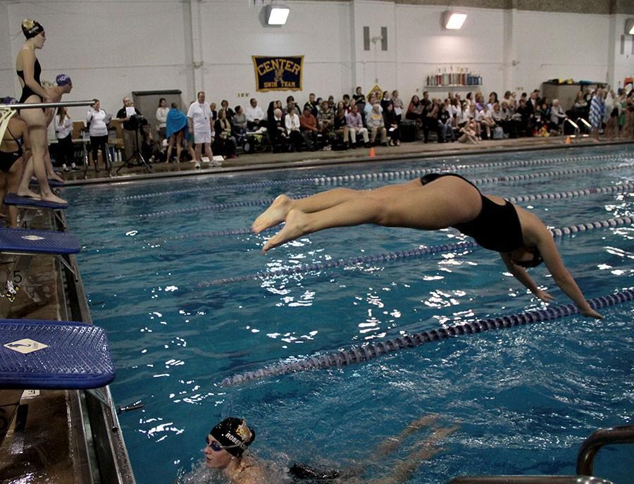 Saint Teresa's swim and dive team kicks off senior night with a relay on Jan 26 at Redbridge YMCA. photo by Kate Scofield