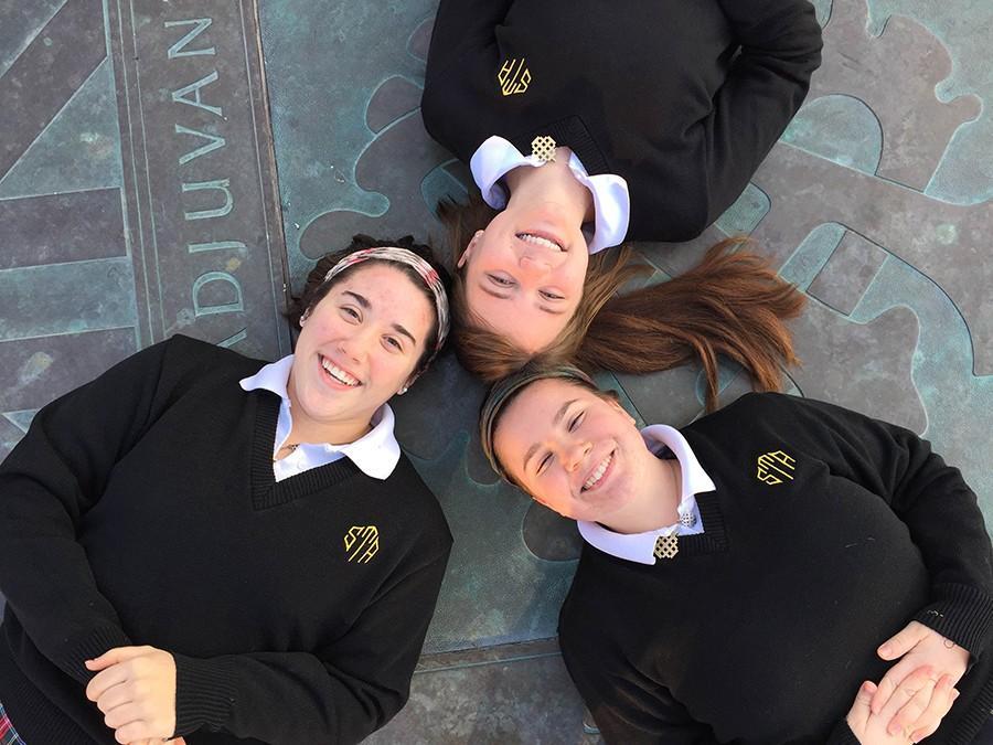 Seniors from left, Kat Mediavilla, Hallie Ryan and Maddy Medina pose on the seal at St. Teresas Academy. photo by Bridget Jones.
