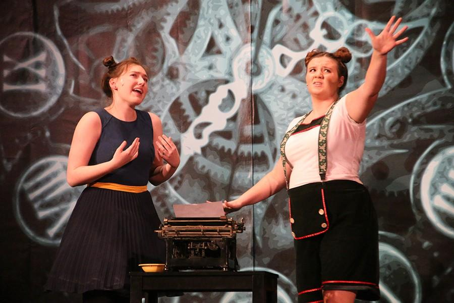 Sophomore Olivia Matlock, right, speaks on stage during tech rehearsal Feb. 17 as sophomore Miranda Collins looks at her. photo by Maggie Knox