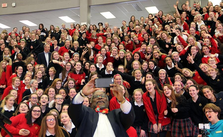 Mayor Sly James snaps a selfie with the student body at the Year of the Young Woman assembly Feb. 1. photo by Paige Powell