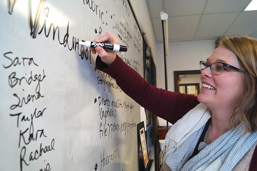 Ms. Scott writes notes on her board so as to encourage this years Windmoor staff. photo by Violet Cowdin