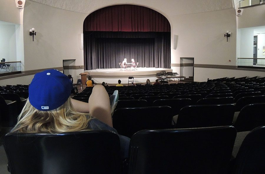 Senior Katie Donaldson watches her cast members rehearse in the auditorium April 21. The name of her production, which she directed with seniors Isabella Meisel and Josie Buford, was