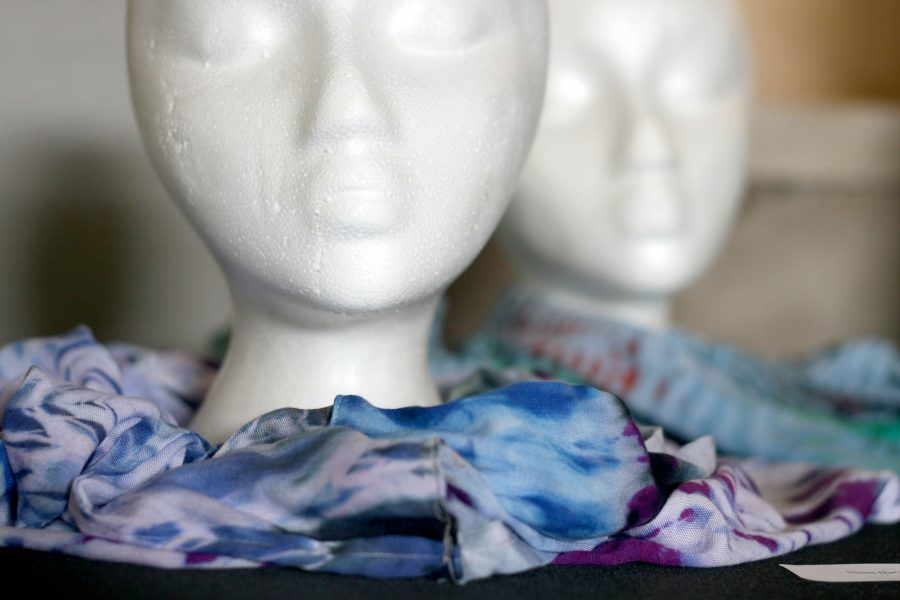 A scarf from a fibers class created by senior Siena Hutchison is displayed at the Fine Arts Showcase at STA on April 27. photo by Kate Scofield