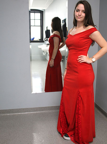 Senior Sarah Gorden strikes a pose as she models her prom dress that she designed and made herself. photo by Paige Powell