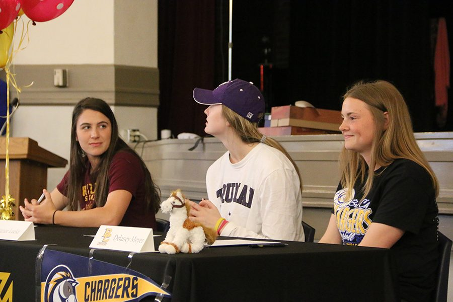 Seniors+Kristina+Coppinger%2C+from+left%2C+Eleanor+Lueke+and+Delaney+Meyer+wait+to+sign+their+letters+of+intent+April+20+to+play+sports+in+college.+photo+by+Maggie+Knox