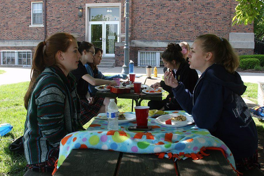 Sophomores Katie Willnauer and Clementina Ferraro sit and talk over lunch. Willnauer and Ferraro are a part of art teacher Lisa Dibble's advisory. photo by Cassie Hayes