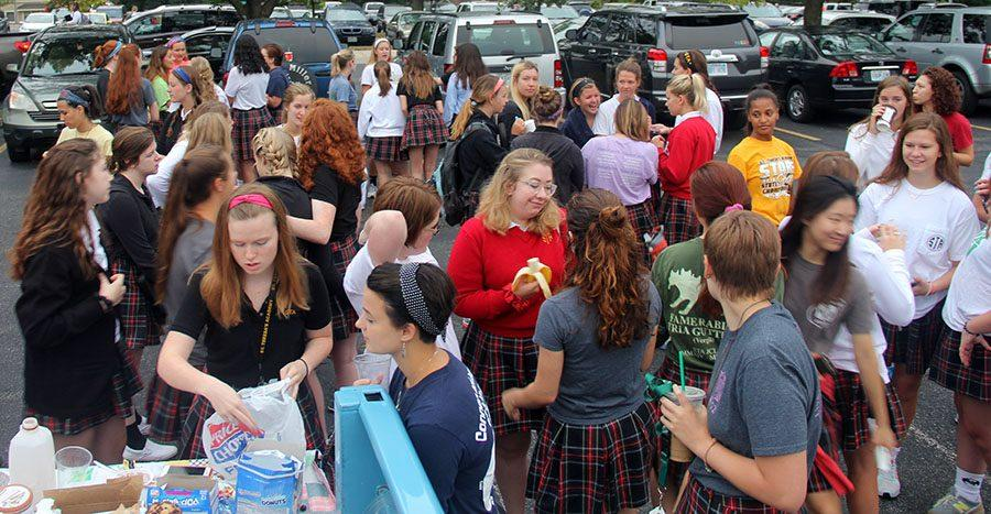 Seniors gather in the parking lot for the first tailgate of the school year. photo by Paige Powell