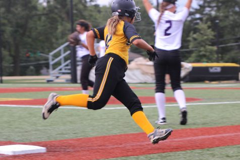 Junior Gabby Pesek sprints from third to home base in hopes of scoring a point for STA The final score for the vasrity softball game was 10-2. photo by Anna Louise Sih
