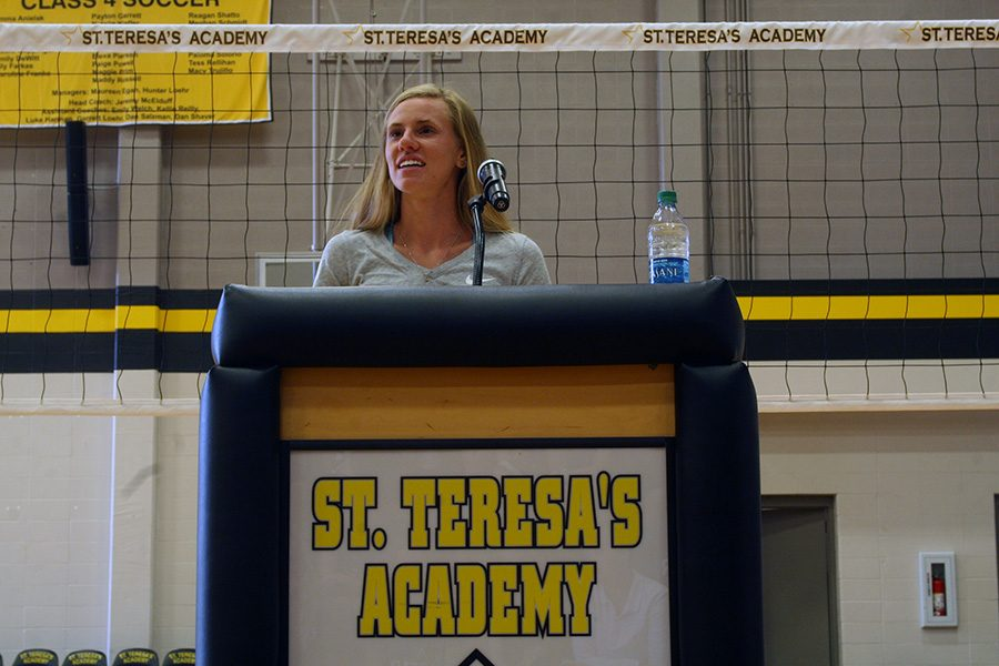 Olympic steeplechase competitor Courtney Frerichs answers STA athletes' questions during a Q&A session in the gym Aug. 29. photo by Cassie Hayes