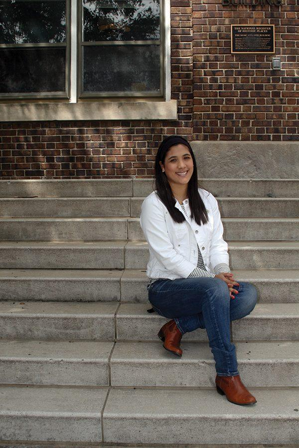 New Spanish teacher Maria Lopez sits in front of the M&A building. photo by Cassie Hayes