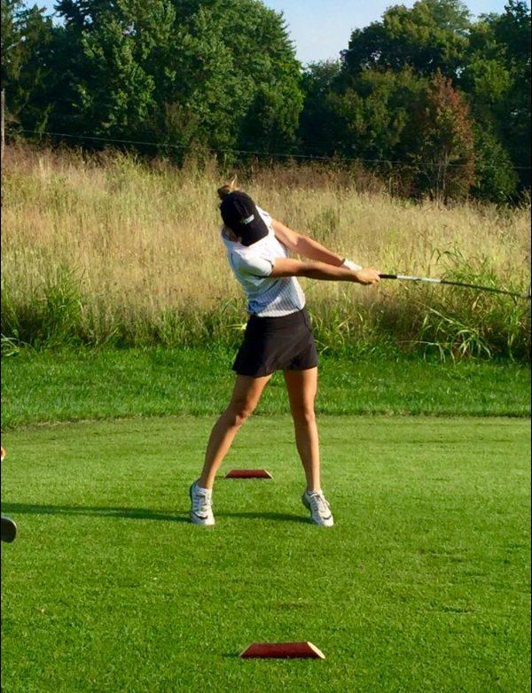 Junior Emma Anielak as she shoots off the tee for a Varsity match. photo courtesy of Larry Hunter-Blank