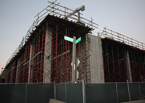 Construction has been underway on the corner of 51st and Oak Streets since June 2015. The Whole Foods, parking garage, and apartment complex are expected to be complete between late 2017 and early 2018. photo by Helen Krause