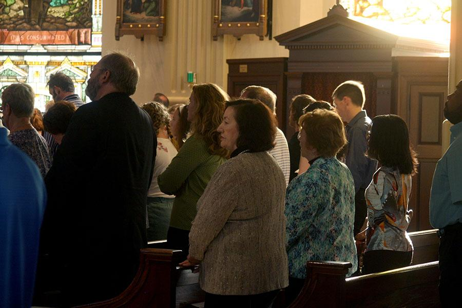 Church attendees rise for the Gospel at the Cathedral of the Immaculate Conception Sept. 22. Mass was held to commemorate the 150 years of service done by the Sisters of St. Joseph of Carondelet. photo by Cassie Hayes
