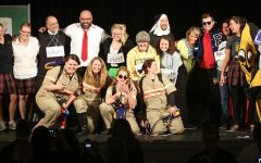 The auction skit cast, made up of teachers, poses for a photo at the end of the skit. photo by Anne Claire Tangen