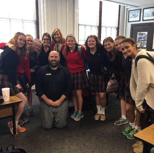 41 Action News anchor Christa Dubill posts with journalism teacher Brad Lewis and journalism students. photo courtsey of Paula Holmquist