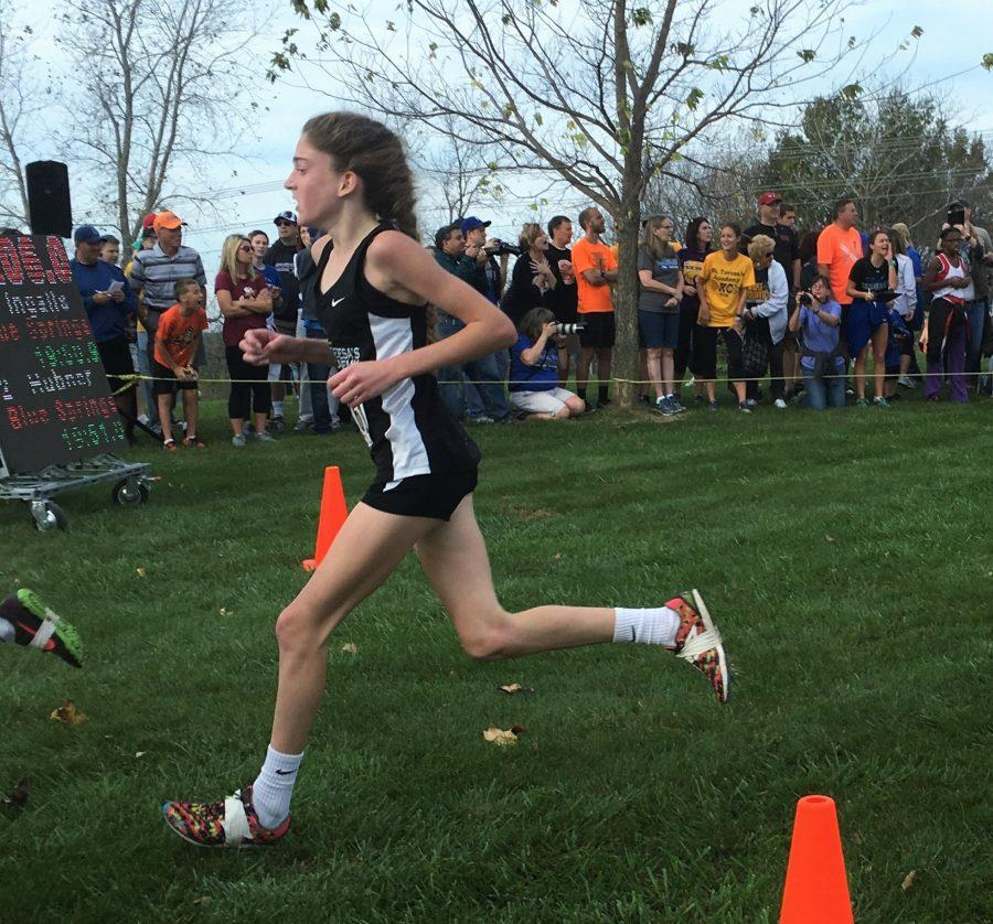 Sophomore Rose Crowe crosses the finish line at the sectional meet. photo by Gabby Mesa
