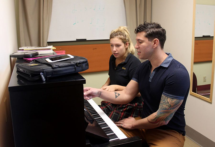 STA piano teacher and accompanist Steven Karlin instructs senior Kayton Froeschl in her piano class in the practice rooms. Students are allowed in the practice room only if an adult is present and if they sign in. photo by Paige Powell