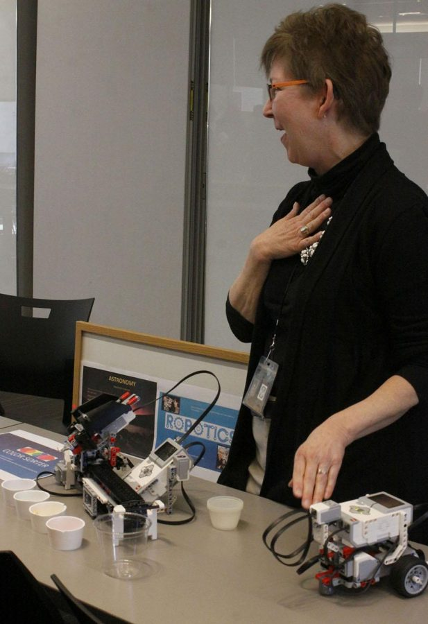 Science teacher Terry Conner explains her robotics course using her own homemade robot to potential students at the first annual STA elective fair on Jan. 12 in the Windmoor Center. photo courtesy of Kate Scofield