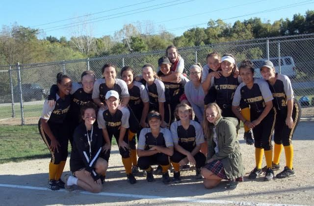 The STA softball team poses for a picture at the District semi-finals game. photo courtesy of Gabirelle Pesek